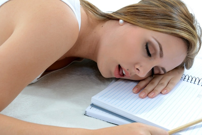 Exhausted woman asleep on desk as she is a perfectionist and tries to make everything perfect.
