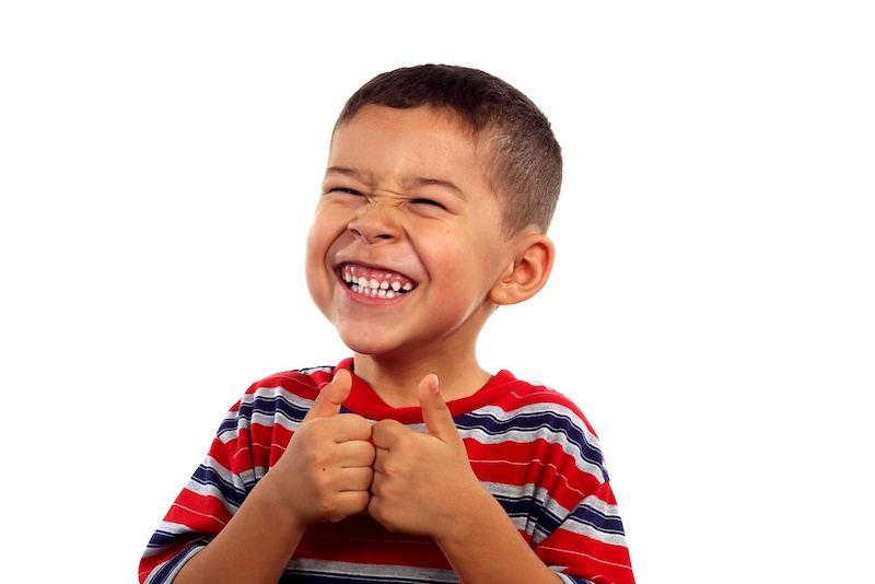 Happy smiling boy with thumbs up. We help our children to cope with bullying in school.