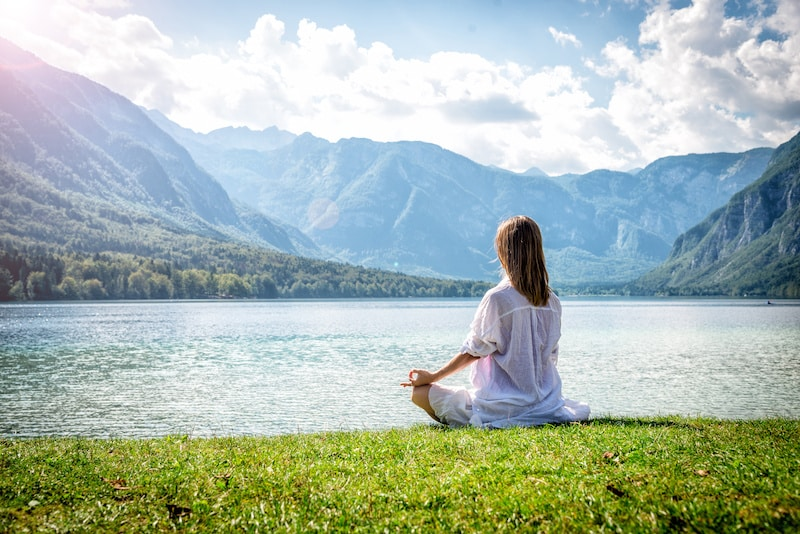 Mantra definition and how to perform one. Woman doing a mantra.