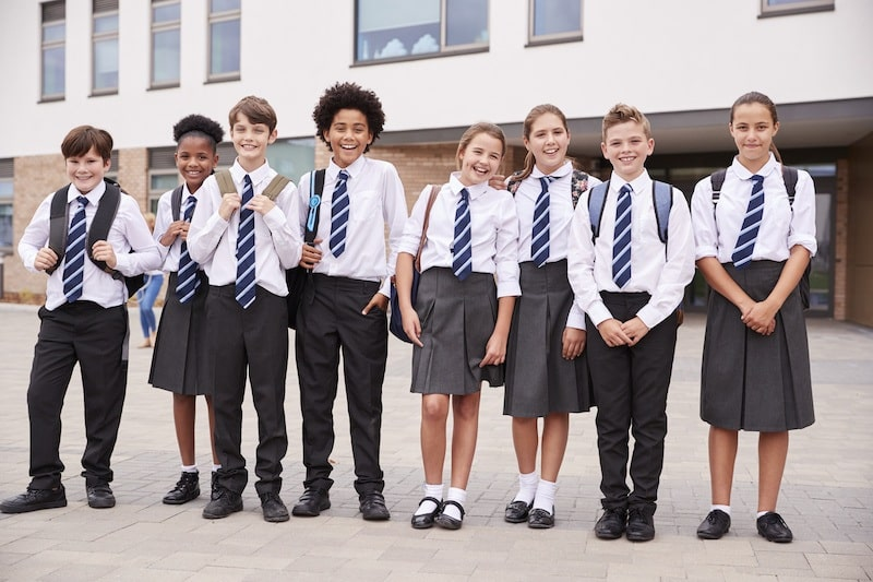 Group of kids looking smart in school uniform ready to start secondary school.
