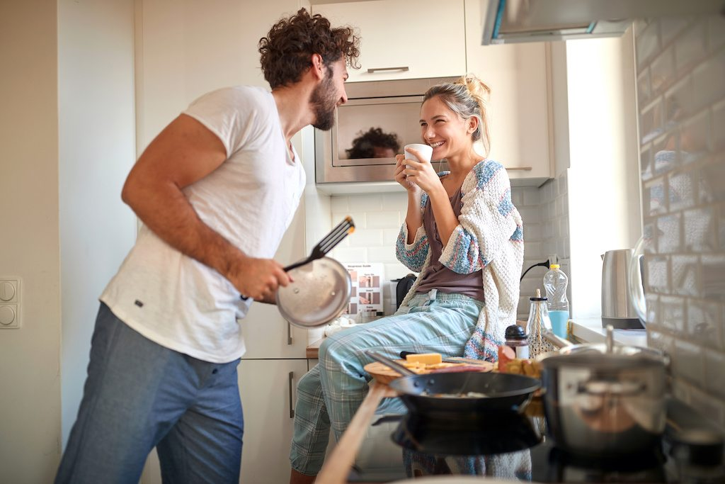 Happy Loving Couple in a kitchen showing emotional freedom