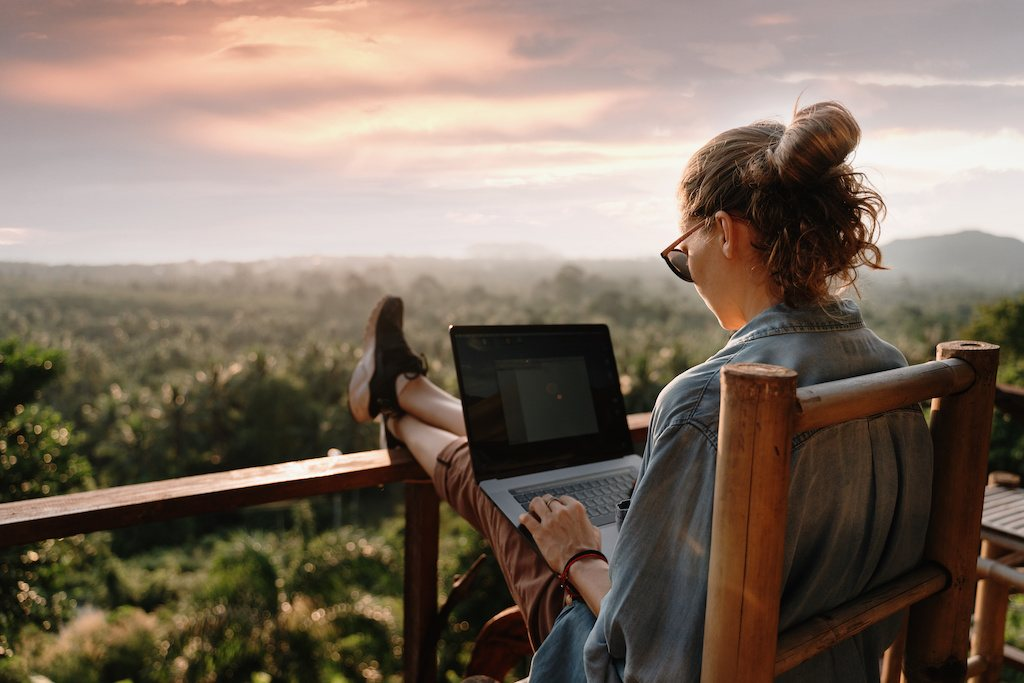 Woman working on laptop with a dream freelance job.