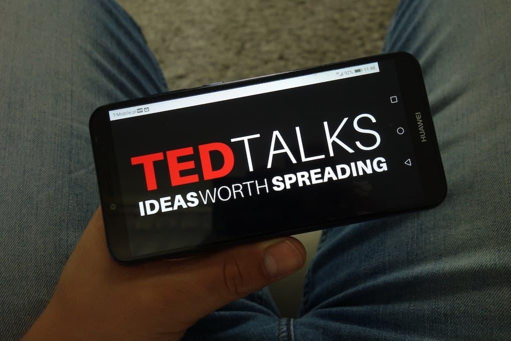 Image of TED talks on phone. Procrastination TED talks